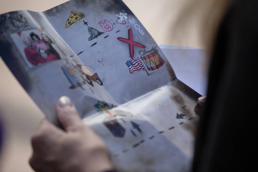 Sandrajean Zahar of Beaumont, Texas, 69, looks at a map with clues during the Alibi Las Vegas in Las Vegas, Saturday, Dec. 30, 2017. Joel Angel Juarez Las Vegas Review-Journal @jajuarezphoto