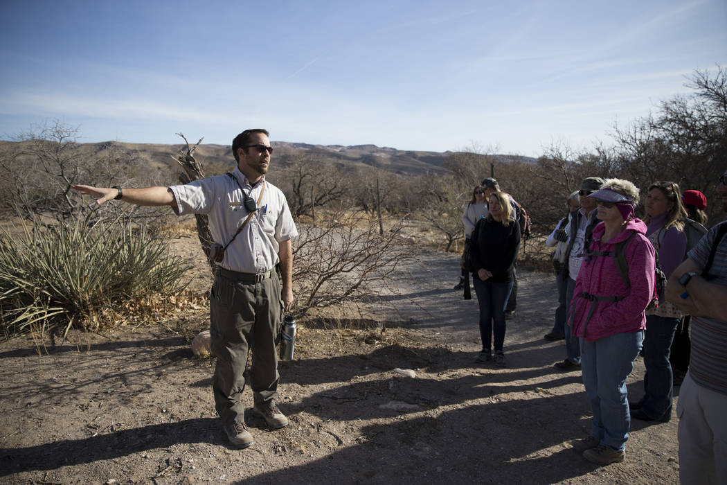 Nevada State Parks Interpreter Ranger Joshua Yelle guides the First Day Hike at Spring Mountain Ranch State Park in Las Vegas, Monday, Jan. 1, 2018. Erik Verduzco Las Vegas Review-Journal @Erik_Ve ...