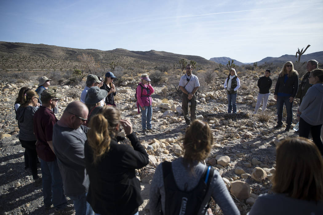 Nevada State Parks Interpreter Ranger Joshua Yelle, center, guides  the First Day Hike at Spring Mountain Ranch State Park in Las Vegas, Monday, Jan. 1, 2018. Erik Verduzco Las Vegas Review-Journa ...