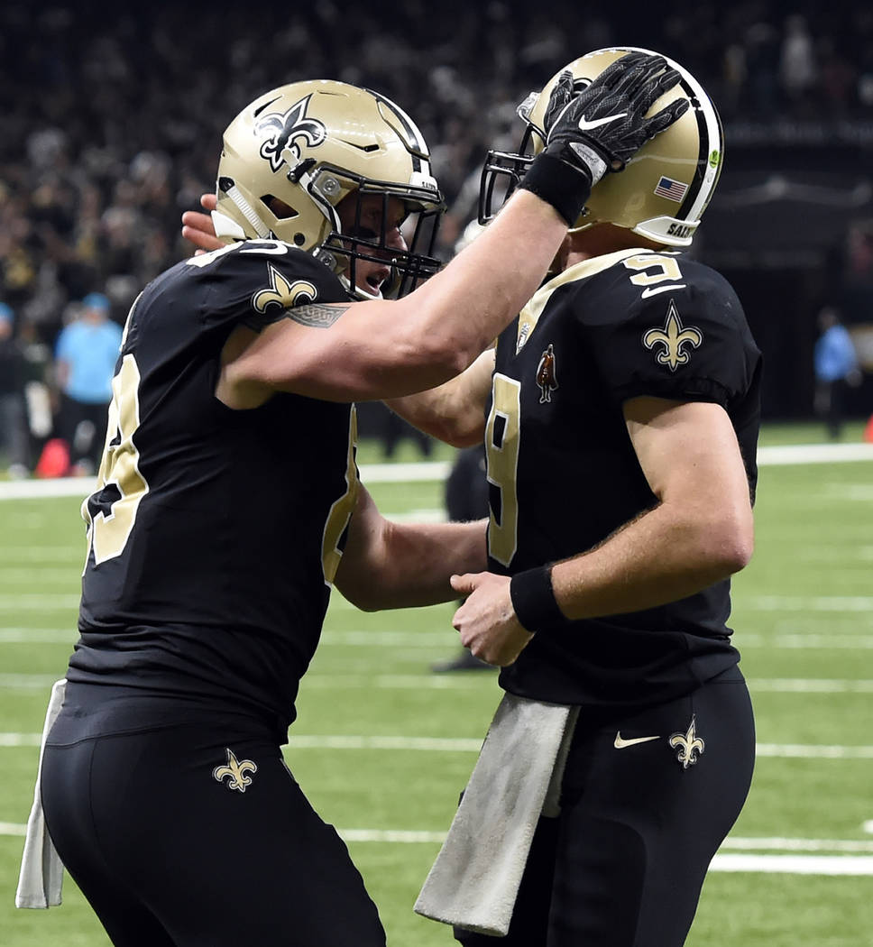 New Orleans Saints tight end Josh Hill, left, celebrates his touchdown reception with quarterback Drew Brees (9) touchdown reception in the first half of an NFL football game against the Carolina  ...