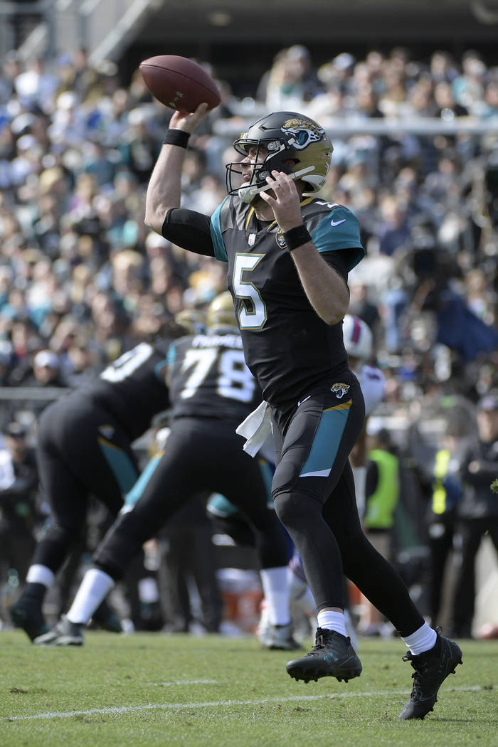 Jacksonville Jaguars quarterback Blake Bortles (5) throws a pass during the first half of an NFL wild-card playoff football game against the Buffalo Bills Sunday, Jan. 7, 2018, in Jacksonville, Fl ...