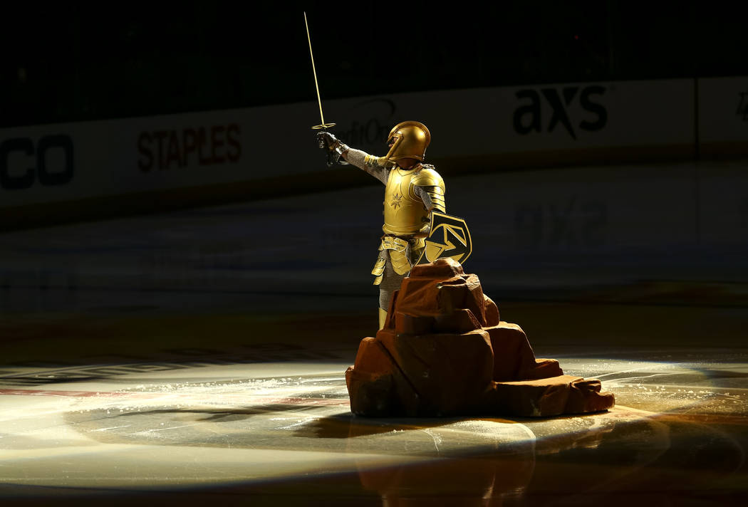 The Golden Knight performs on the ice before an NHL hockey game between the Vegas Golden Knights and the Nashville Predators at the T-Mobile Arena in Las Vegas, Tuesday, Jan. 02, 2018. Richard Bri ...