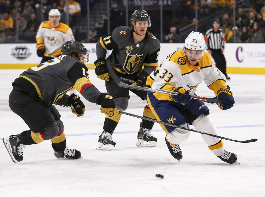 Nashville Predators left wing Viktor Arvidsson (33) gets past Vegas Golden Knights left wing Brendan Leipsic (13) as Knights center Cody Eakin (21) trails behind during the second period of an NHL ...