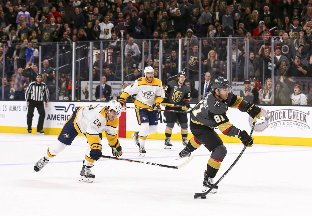 Vegas Golden Knights center Jonathan Marchessault (81) breaks away from Nashville Predators left wing Kevin Fiala (22) to score an empty-net goal during the third period of an NHL hockey game betw ...