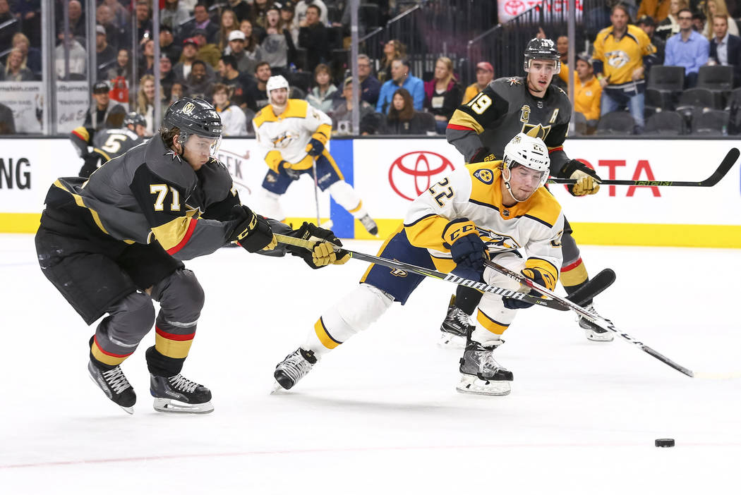 Vegas Golden Knights center William Karlsson (71) and Nashville Predators left wing Kevin Fiala (22) vie for the puck during the second period of an NHL hockey game between the Vegas Golden Knight ...