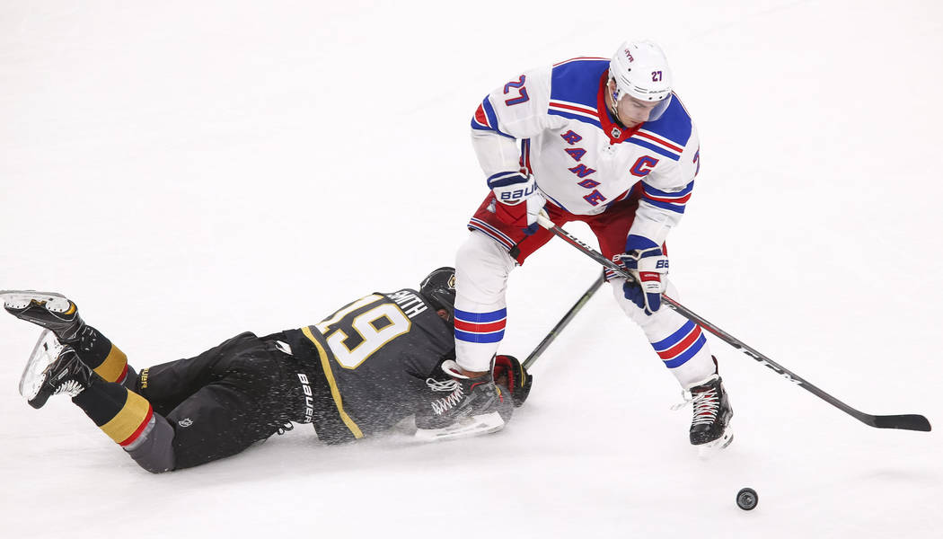 Vegas Golden Knights right wing Reilly Smith (19) falls to the ice defending New York Rangers defenseman Ryan McDonagh (27) during the third period of an NHL hockey game between the Vegas Golden K ...