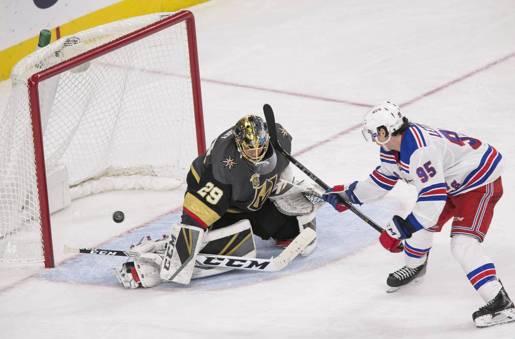 Vegas Golden Knights goaltender Marc-Andre Fleury (29) blocks a shot from New York Rangers center Vinni Lettieri (95) during the third period of an NHL hockey game between the Vegas Golden Knights ...
