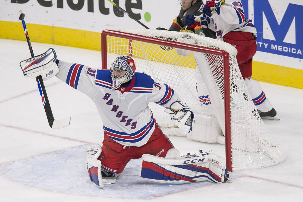 New York Rangers goaltender Ondrej Pavelec (31) blocks a puck with his stick during the second period of an NHL hockey game between the Vegas Golden Knights and the New York Rangers at the T-Mobil ...