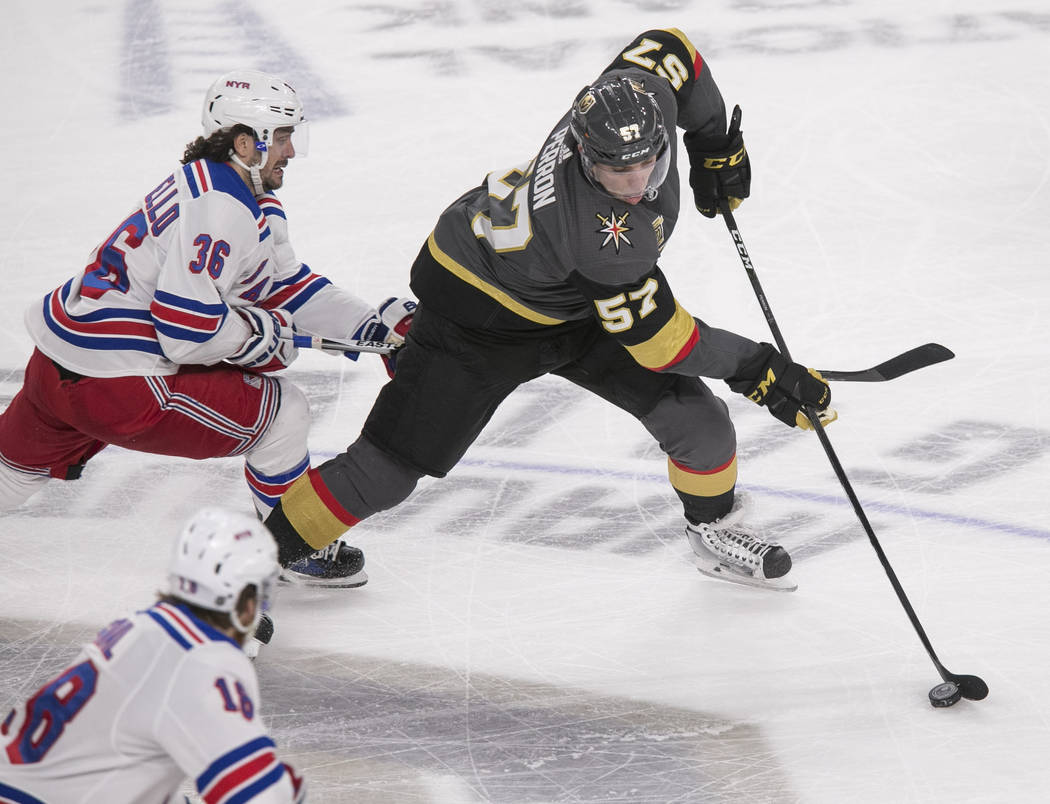 Vegas Golden Knights left wing David Perron (57) controls the puck as New York Rangers right wing Mats Zuccarello (36) defends during the third period of an NHL hockey game between the Vegas Golde ...