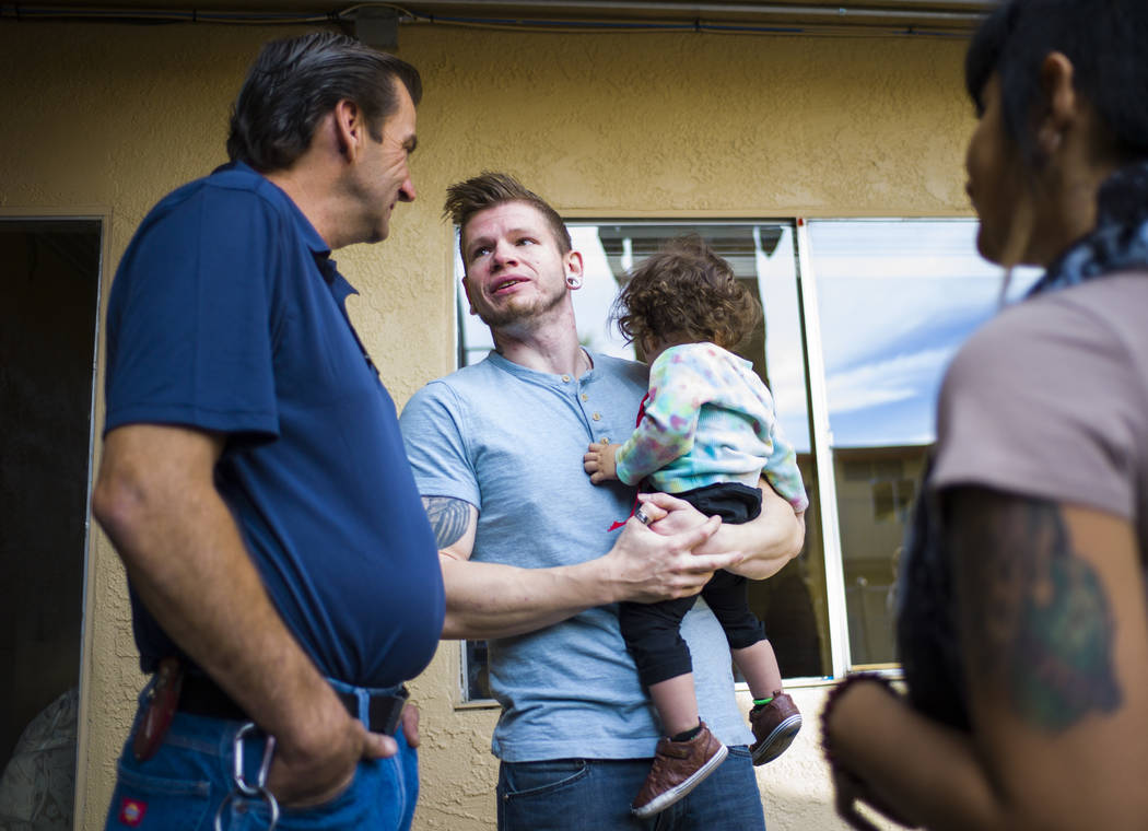 Andrew Keeler, center, holds his son, Valen, while talking with Richard Simmons during the anniversary celebration for Freedom House and Freedom Behavior Health in Las Vegas on Wednesday, Nov. 29, ...