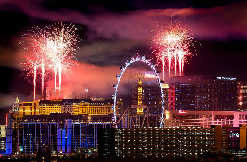 The fireworks of America's Party 2018 explode over the Las Vegas Strip to welcome the new year in this view from the rooftop of the Convention Center Marriott in Las Vegas on Monday, Jan. 1, 2018. ...