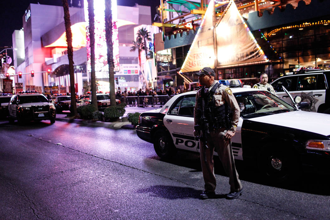 A police officer stands along the Strip on New Year's Eve in Las Vegas, Sunday, Dec. 31, 2017. Joel Angel Juarez Las Vegas Review-Journal @jajuarezphoto