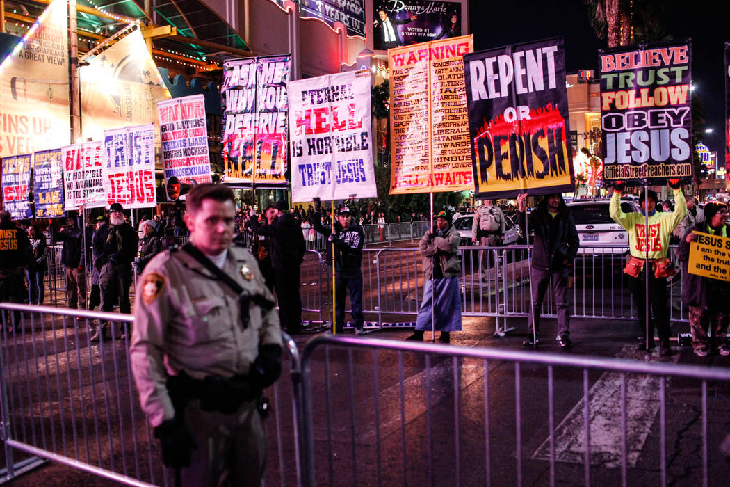 Street preachers stand along the Strip on New Year's Eve in Las Vegas, Sunday, Dec. 31, 2017. Joel Angel Juarez Las Vegas Review-Journal @jajuarezphoto