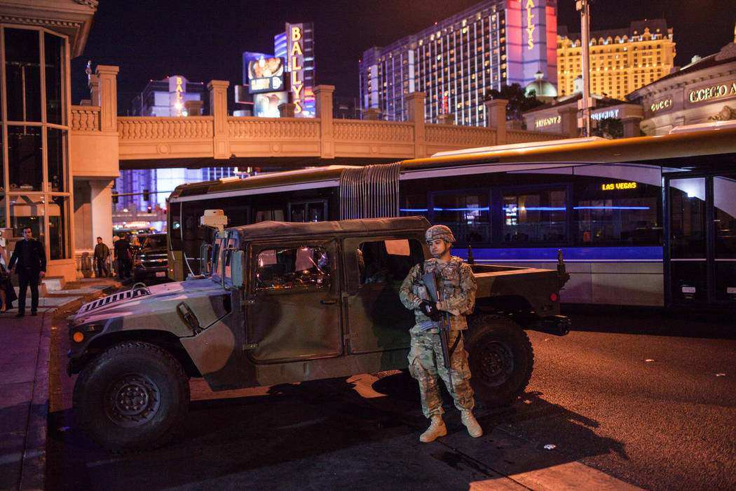 A member of the National Guard stands nearby a closed road along the Strip on New Year's Eve in Las Vegas, Sunday, Dec. 31, 2017. Joel Angel Juarez Las Vegas Review-Journal @jajuarezphoto