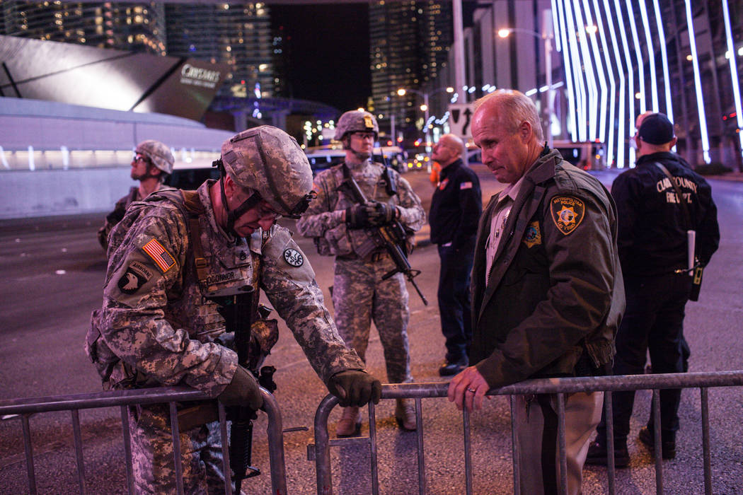 A member of the National Guard and a police officer close off a barricade along the Strip on New Year's Eve in Las Vegas, Sunday, Dec. 31, 2017. Joel Angel Juarez Las Vegas Review-Journal @jajuare ...