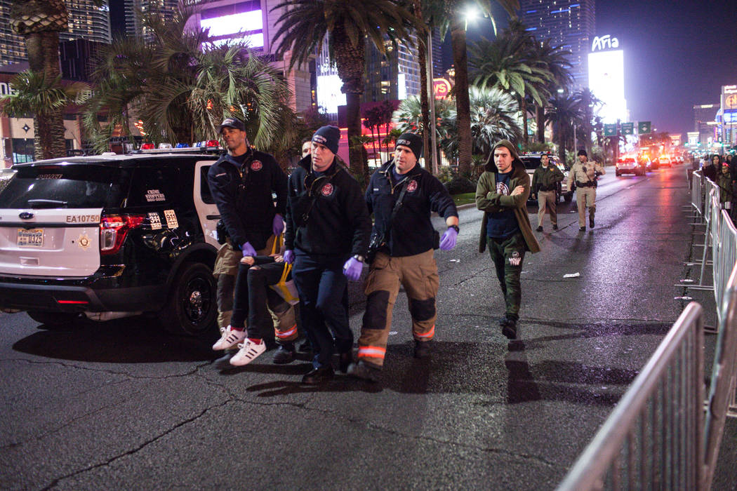 Emergency personnel carry a person to an ambulance along the Strip on New Year's Eve in Las Vegas, Sunday, Dec. 31, 2017. Joel Angel Juarez Las Vegas Review-Journal @jajuarezphoto