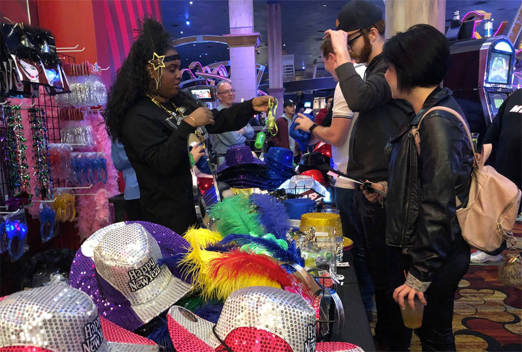 Vendors sell hats at New York-New York on the Las Vegas Strip on Dec. 31, 2017. (Briana Erickson/Las Vegas Review-Journal)