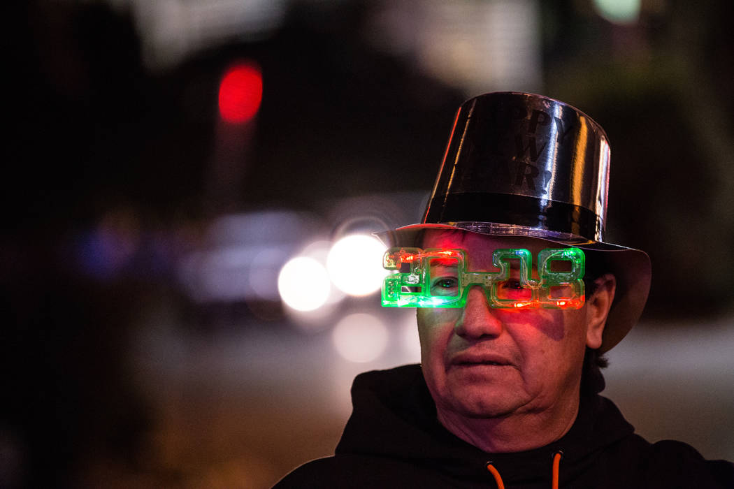 Helder Del Valle of San Francisco, 54, stands along the Strip on New Year's Eve in Las Vegas, Sunday, Dec. 31, 2017. Joel Angel Juarez Las Vegas Review-Journal @jajuarezphoto