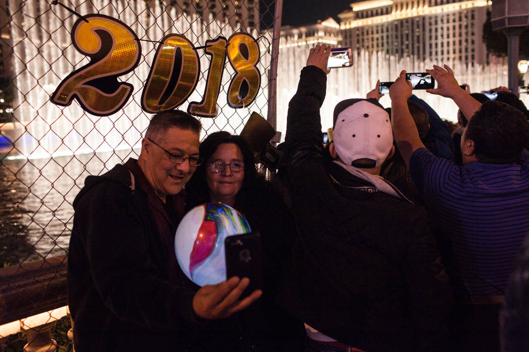 People gather in front of the Bellagio along the Strip on New Year's Eve in Las Vegas, Sunday, Dec. 31, 2017. Joel Angel Juarez Las Vegas Review-Journal @jajuarezphoto