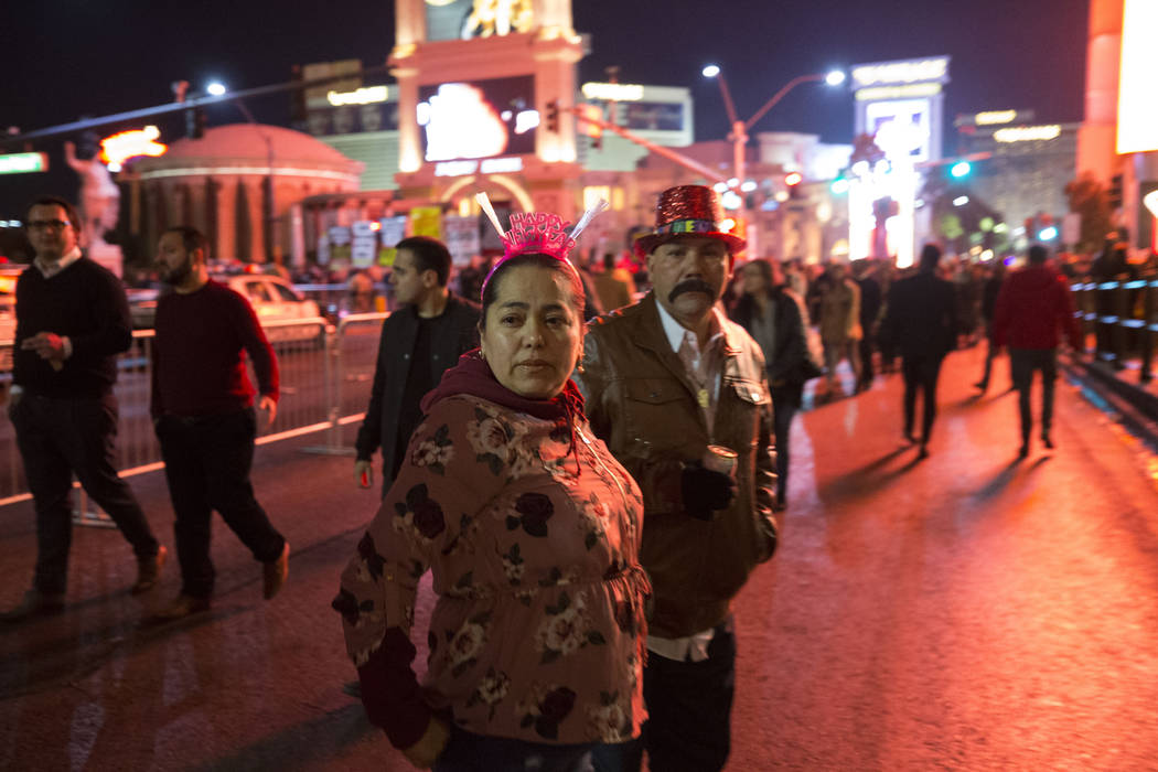 People walk on the Strip on New Year's Eve, Sunday, Dec. 31, 2017. Richard Brian Las Vegas Review-Journal @vegasphotograph