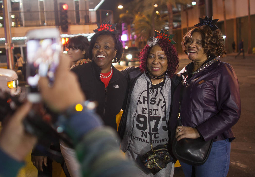 Natlynn Johnson, from left, Ruby Shearry, and Pat Gaffney have their picture taken with New Year crowns on in downtown Las Vegas, Sunday, Dec. 31, 2017. Rachel Aston Las Vegas Review-Journal @rook ...