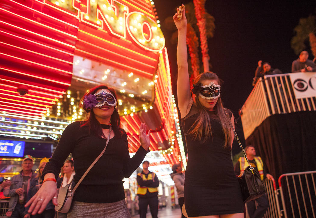 Devilan Chaney, left, and Panda Chaney dance at the Fremont Street Experience in Las Vegas, Sunday, Dec. 31, 2017. Rachel Aston Las Vegas Review-Journal @rookie__rae