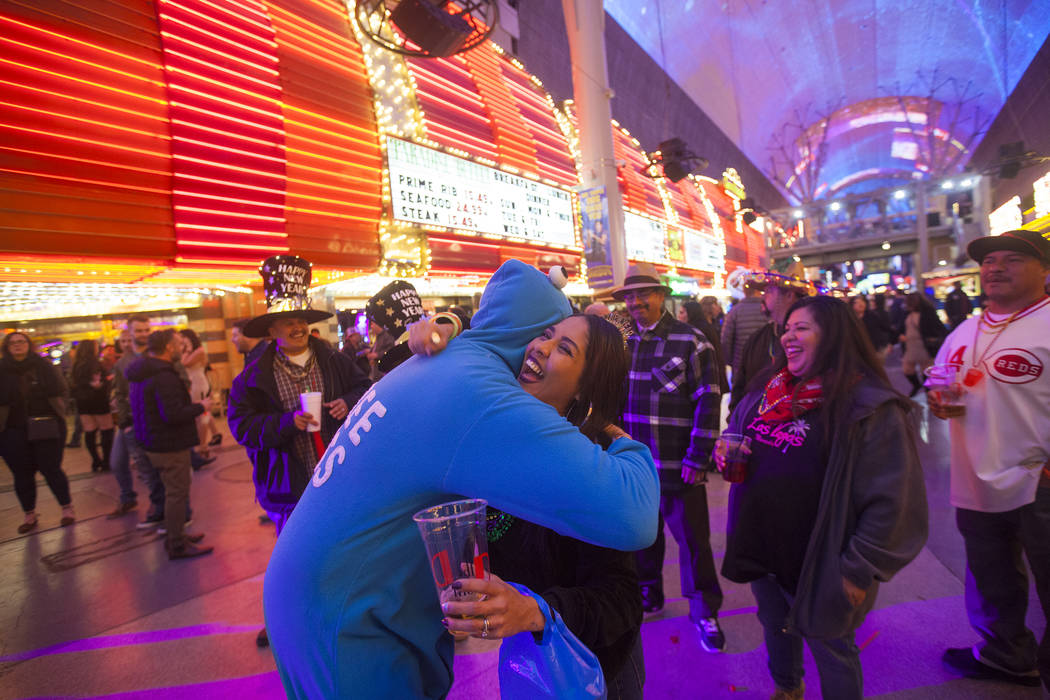 Marty Beckers hugs Teresa Knight at the Fremont Street Experience New Year's Eve celebration in Las Vegas, Sunday, Dec. 31, 2017. Rachel Aston Las Vegas Review-Journal @rookie__rae