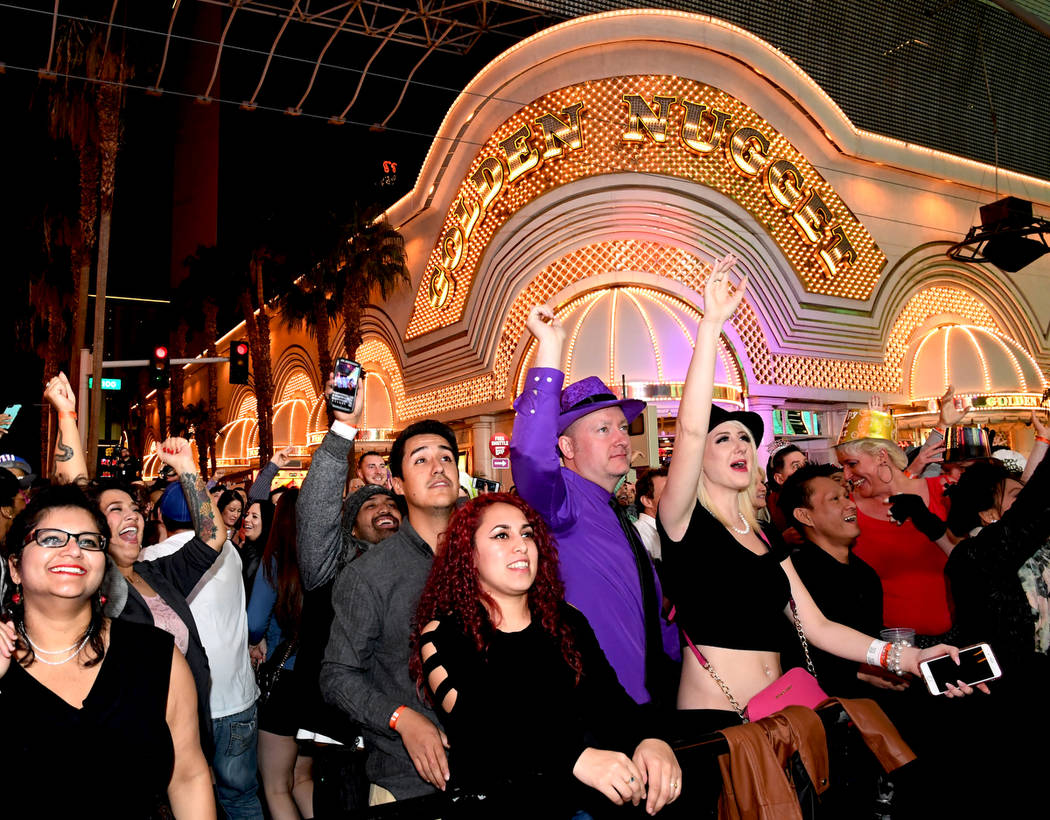 """America's Party 2018,"" the fireworks and entertainment extravaganza, rang in the New Year in classic Las Vegas style. In downtown Las Vegas at the Fremont Street Experience, party-goers saw ..."