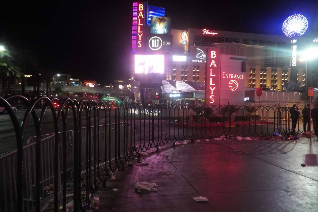 Trash from New Year's Eve celebrations litters the Las Vegas Strip outside the CVS store near Harmon Avenue early Monday, Jan. 1, 2018. (Max Michor/Las Vegas Review-Journal)