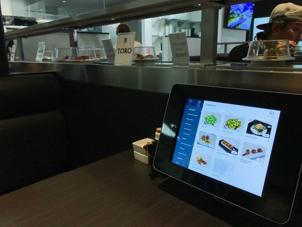Customers can order additional items like kitchen specials and dessert from iPads at their table. (Madelyn Reese/View) @MadelynGReese