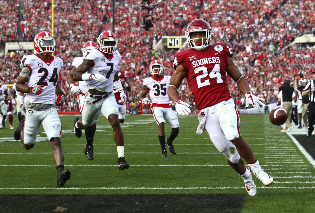 Oklahoma Sooners running back Rodney Anderson (24) scores a touchdown against the Georgia Bulldogs during the first half of the College Football Playoff semifinal at the Rose Bowl in Pasadena, Cal ...