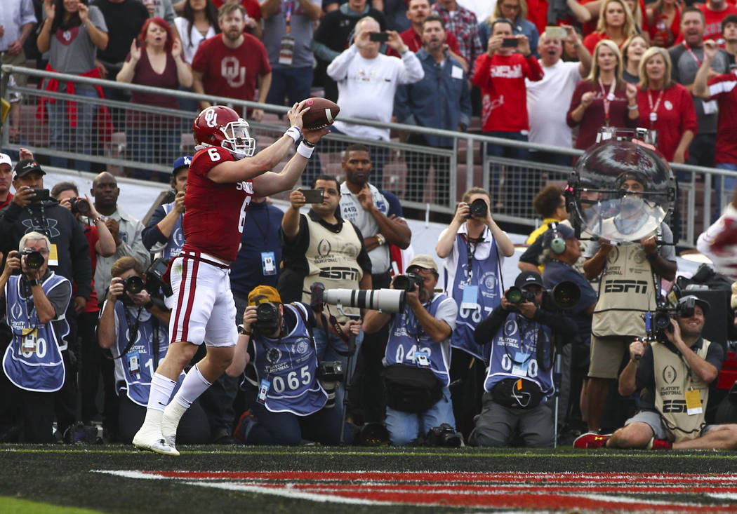 Oklahoma Sooners quarterback Baker Mayfield (6) catches for a touchdown against the Georgia Bulldogs during the first half of the College Football Playoff semifinal at the Rose Bowl in Pasadena, C ...