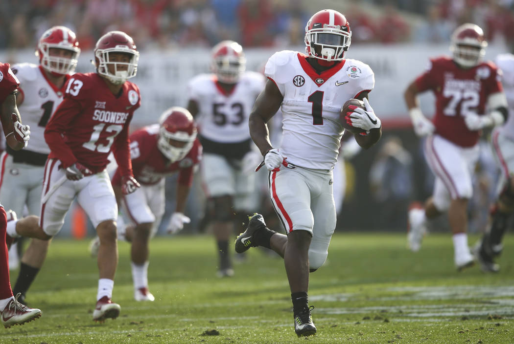Georgia Bulldogs running back Sony Michel (1) runs the ball to score a touchdown during the first half of the College Football Playoff semifinal at the Rose Bowl in Pasadena, Calif. on Monday, Jan ...