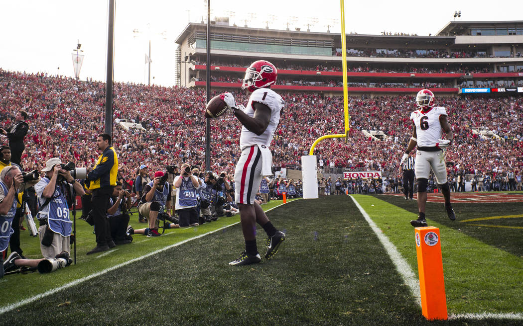 Georgia Bulldogs running back Sony Michel (1) scores a touchdown against the Oklahoma Sooners during the first half of the College Football Playoff semifinal at the Rose Bowl in Pasadena, Calif. o ...