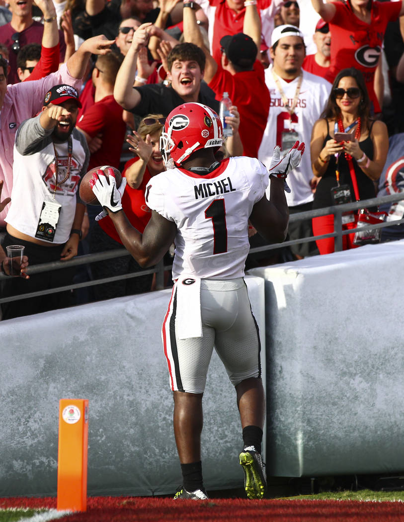 Georgia Bulldogs running back Sony Michel (1) celebrates his touchdown with fans while playing the Oklahoma Sooners in the first half of the College Football Playoff semifinal at the Rose Bowl in  ...