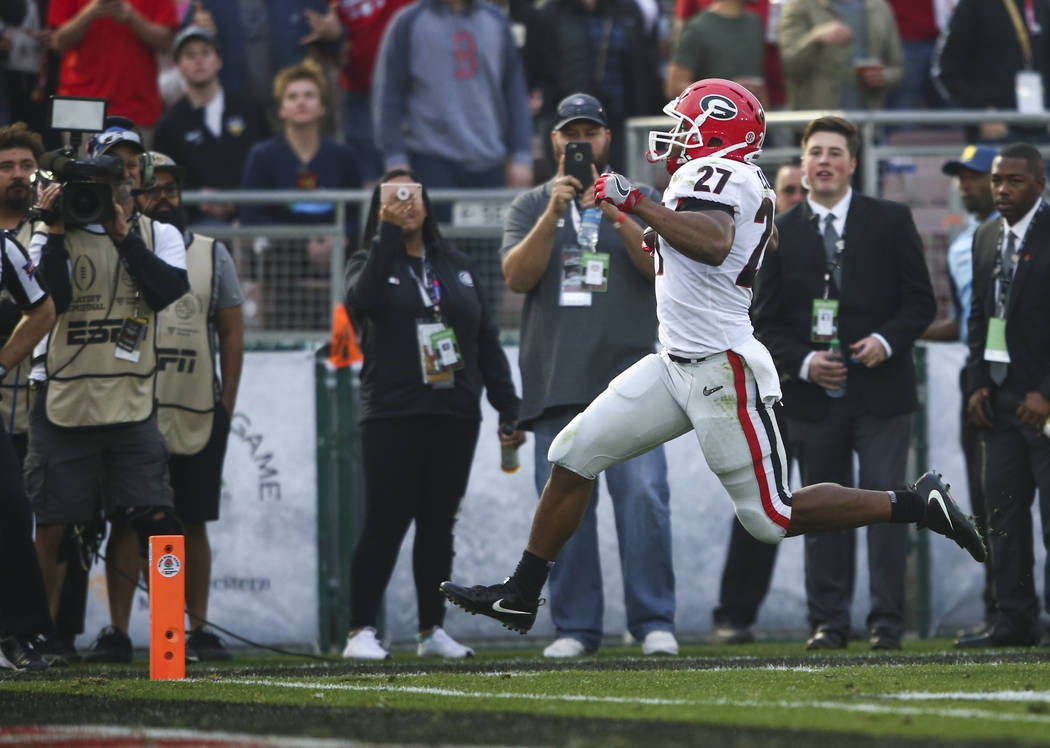 Georgia Bulldogs running back Nick Chubb (27) leaps into the end zone to score a touchdown against the Oklahoma Sooners during the second half of the College Football Playoff semifinal at the Rose ...