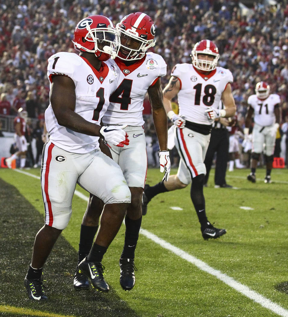 Georgia Bulldogs running back Sony Michel (1) celebrates his touchdown with Georgia Bulldogs wide receiver Mecole Hardman (4) during the second half of the College Football Playoff semifinal again ...