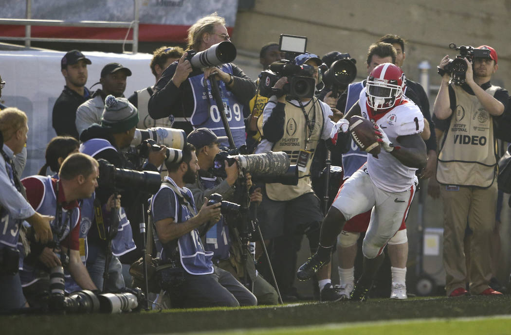 Georgia Bulldogs running back Sony Michel (1) scores a touchdown against the Oklahoma Sooners during the second half of the College Football Playoff semifinal at the Rose Bowl in Pasadena, Calif.  ...