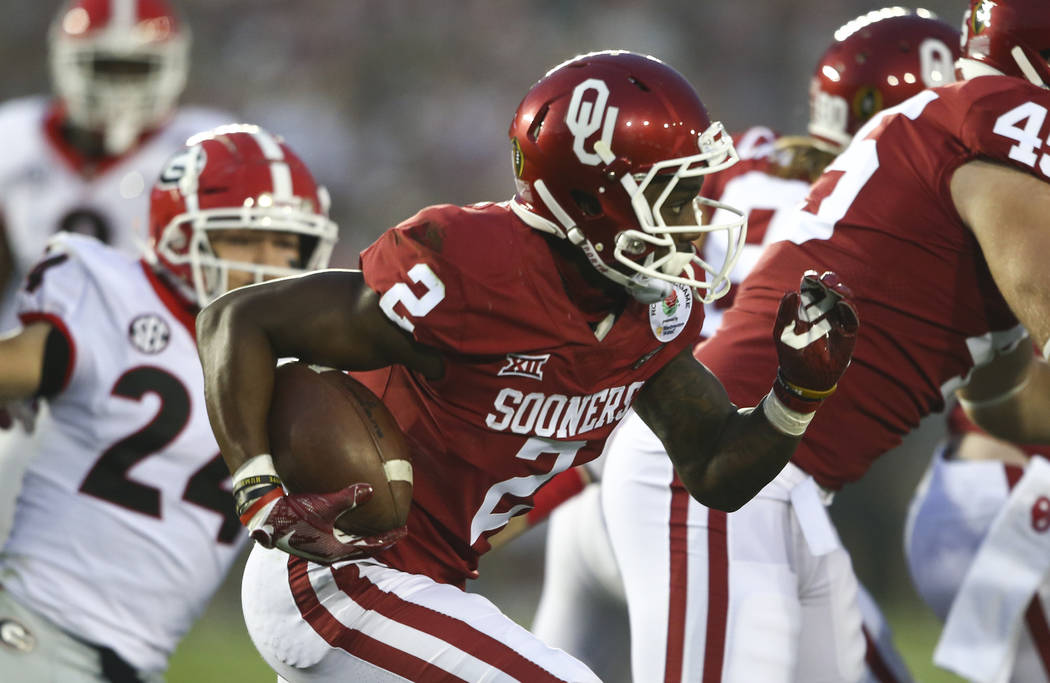 Oklahoma Sooners wide receiver Jeff Badet (2) runs the ball against the Georgia Bulldogs during the second half of the College Football Playoff semifinal at the Rose Bowl in Pasadena, Calif. on Mo ...