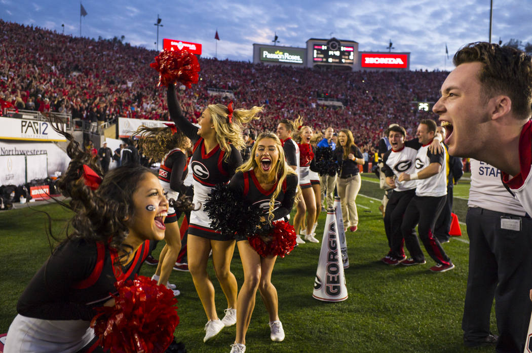 Georgia Bulldogs cheerleaders react after the team intercepted the ball against the Oklahoma Sooners during the second half of the College Football Playoff semifinal at the Rose Bowl in Pasadena,  ...