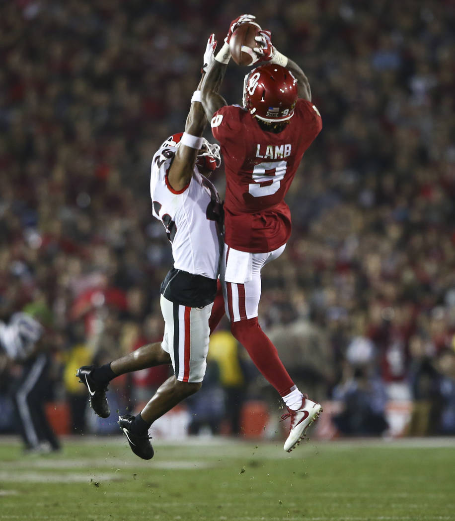 Oklahoma Sooners wide receiver CeeDee Lamb (9) goes up for a pass against Georgia Bulldogs defensive back Tyrique McGhee (26) during the second half of the College Football Playoff semifinal at th ...