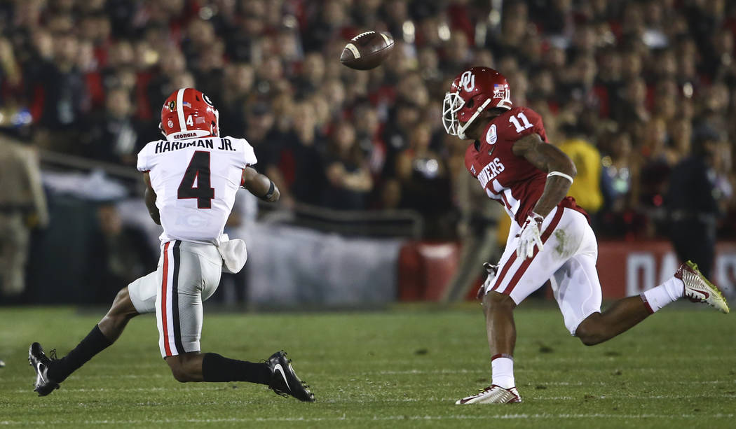 Georgia Bulldogs wide receiver Mecole Hardman Jr. (4) reaches out for a reception as Oklahoma Sooners cornerback Parnell Motley (11) looks on during the second half of the College Football Playoff ...