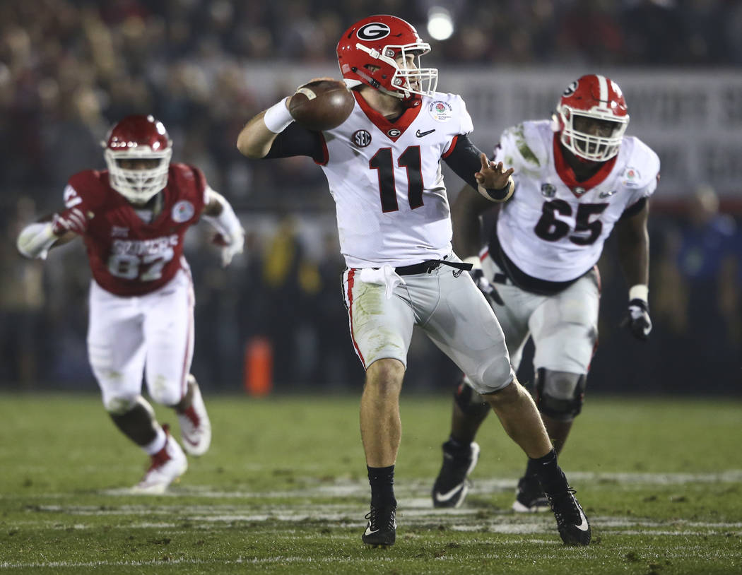 Georgia Bulldogs quarterback Jake Fromm (11) looks to pass the ball during the second half of the College Football Playoff semifinal at the Rose Bowl in Pasadena, Calif. on Monday, Jan. 1, 2018. C ...