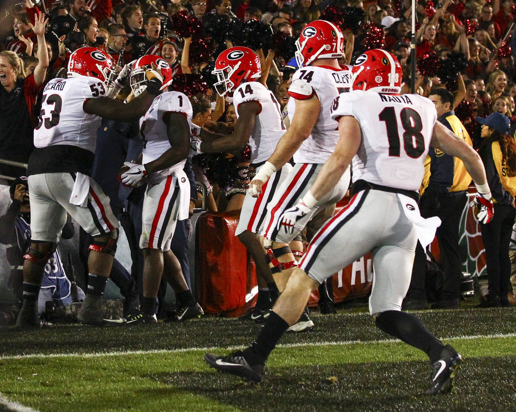 Georgia Bulldogs running back Sony Michel (1) celebrates his game-winning touchdown with Georgia Bulldogs center Lamont Gaillard (53) in double overtime during  the College Football Playoff semifi ...