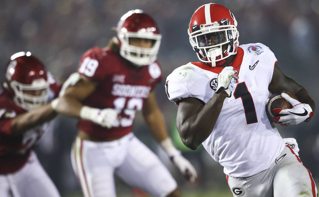 Georgia Bulldogs running back Sony Michel (1) runs the ball to score the game-winning touchdown against the Oklahoma Sooners in double overtime during  the College Football Playoff semifinal again ...