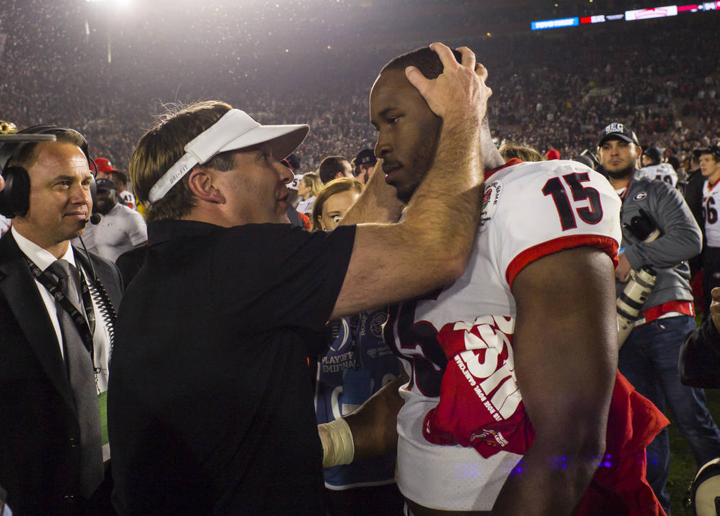 Georgia Bulldogs head coach Kirby Smart and linebacker D'Andre Walker (15) react after the team's double overtime defeat against the Oklahoma Sooners in the College Football Playoff semifinal at t ...