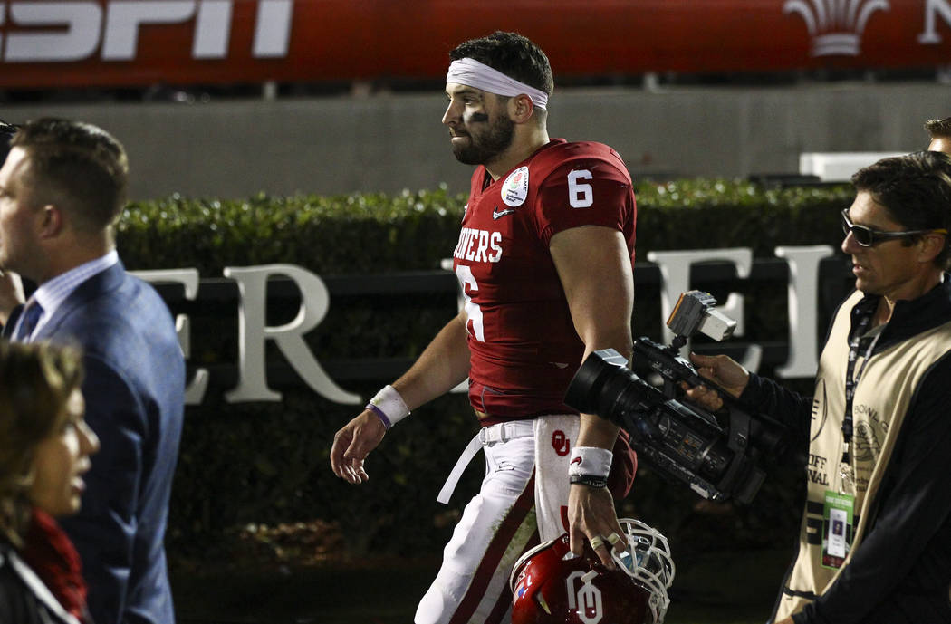 Oklahoma Sooners quarterback Baker Mayfield (6) walks off the field after a double overtime loss to the Georgia Bulldogs in the College Football Playoff semifinal at the Rose Bowl in Pasadena, Cal ...