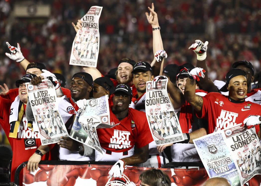 Georgia Bulldogs players react after their double overtime defeat against the Oklahoma Sooners in the College Football Playoff semifinal at the Rose Bowl in Pasadena, Calif. on Monday, Jan. 1, 201 ...