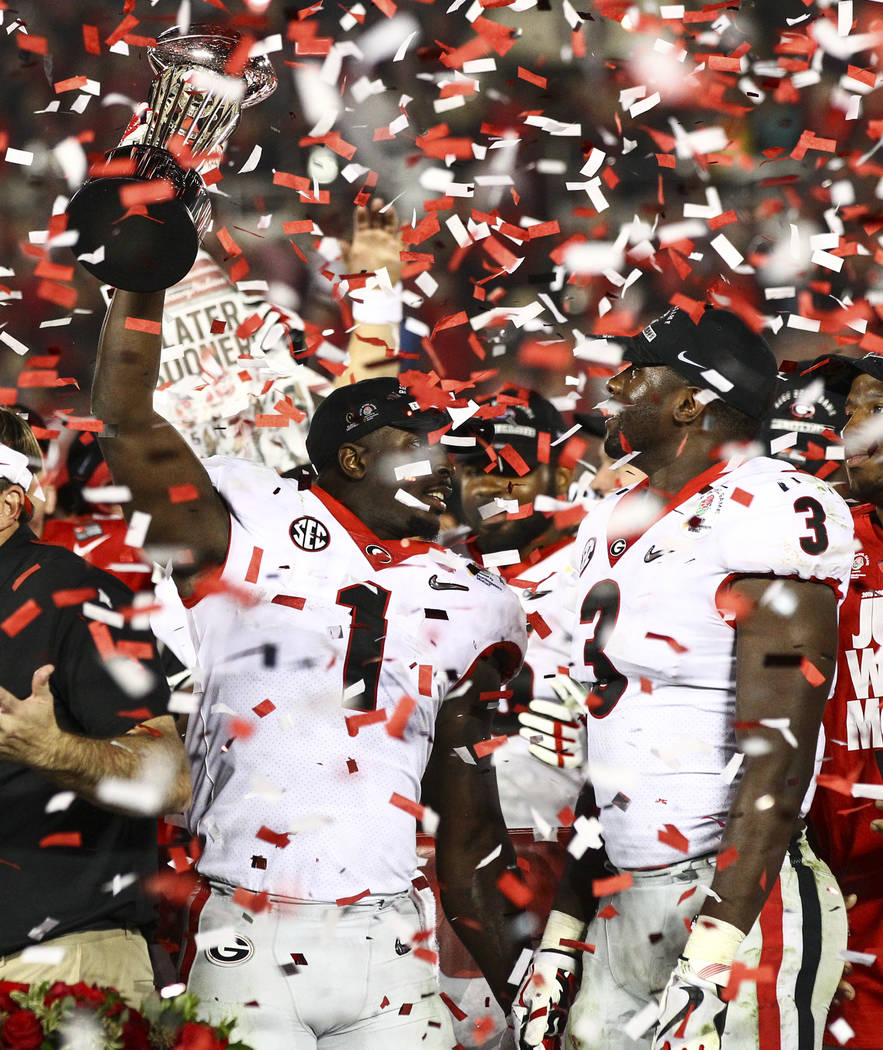 Georgia Bulldogs' Sony Michel (1) and Roquan Smith (3)  celebrate their double overtime defeat against the Oklahoma Sooners in the College Football Playoff semifinal at the Rose Bowl in Pasadena,  ...