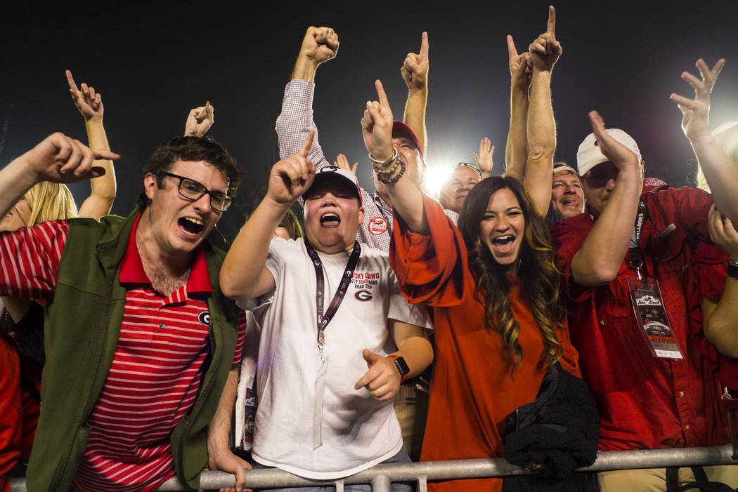 Georgia Bulldogs fans celebrate their team's double overtime defeat against the Oklahoma Sooners in the College Football Playoff semifinal at the Rose Bowl in Pasadena, Calif. on Monday, Jan. 1, 2 ...